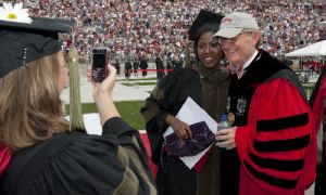 Gordon Gee Takes Picture With a Recent Graduate